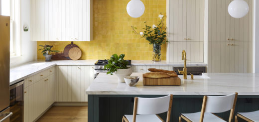 a cottage kitchen with bold yellow backsplash