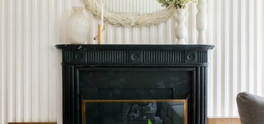 fluted plaster walls and a classic black fireplace in a sitting room kips bay showhouse by sarah bartholomew