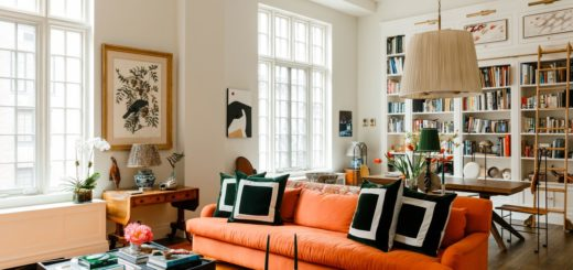 orange sofa in a white loft living room space