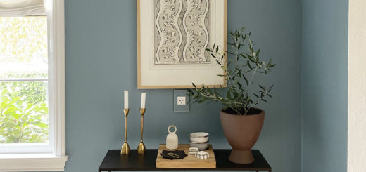 small vignette in dining room with art and console