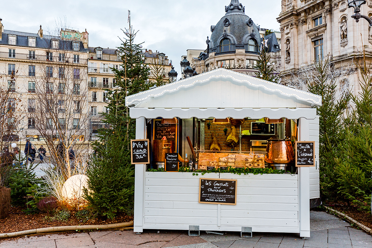 vin chaud mulled wine and cheese food stands in the christmas markets in paris