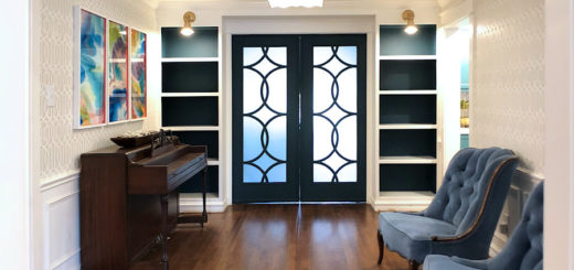 current music room with backs of bookcases painted dark teal, dark teal doors, and white and gray walls
