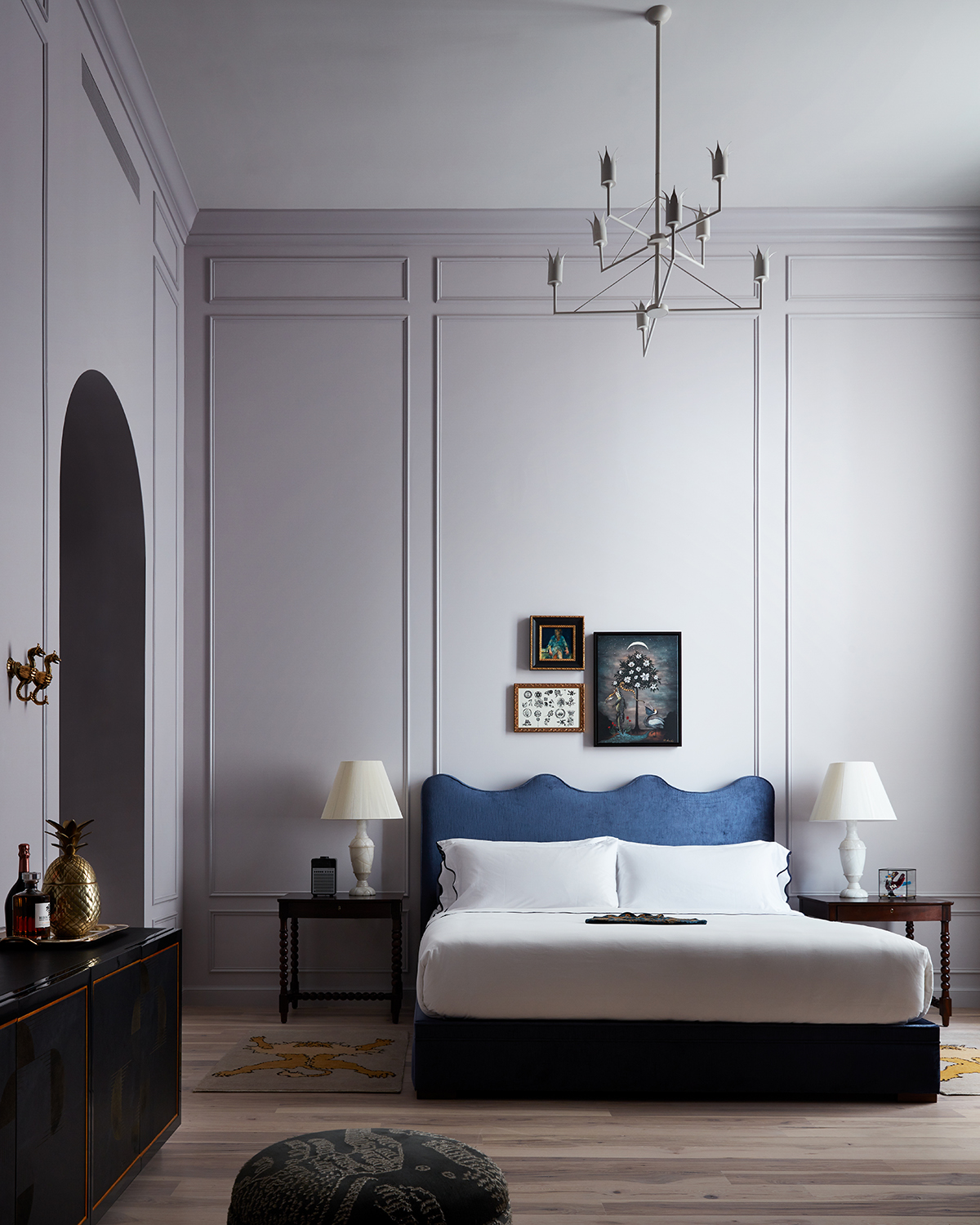 soft lilac walls and a bold blue bed